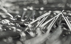 pile-of-paper-clips-shallow-focus-macro-dolly-shot_sjaytomz__F0000